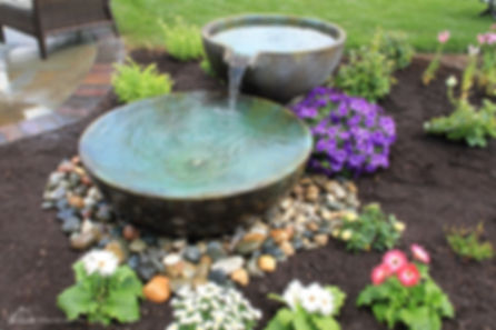 Spillway bowl water features are great to attract birds to a backyard patio or nestled with attractive plants in your Omaha front yard landscaping.