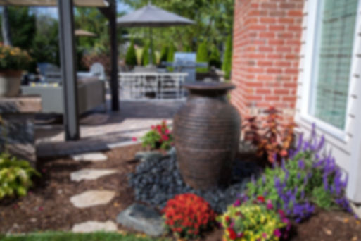 Single urn water features add a relaxing element to your backyard patio area.