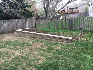 Retaining walls are often required to keep areas of your Omaha yard secure.