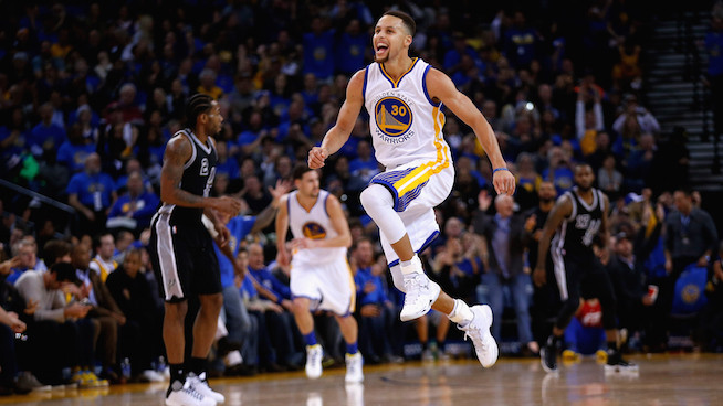 OAKLAND, CA - JANUARY 25: Stephen Curry #30 of the Golden State Warriors reacts after he made a shot against the San Antonio Spurs in the third quarter at ORACLE Arena on January 25, 2016 in Oakland, California. NOTE TO USER: User expressly acknowledges and agrees that, by downloading and or using this photograph, User is consenting to the terms and conditions of the Getty Images License Agreement. (Photo by Ezra Shaw/Getty Images)