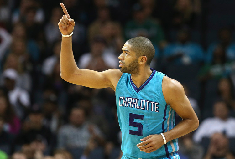 CHARLOTTE, NC - DECEMBER 12: Nicolas Batum #5 of the Charlotte Hornets reacts after a play during their game against the Boston Celtics at Time Warner Cable Arena on December 12, 2015 in Charlotte, North Carolina. NOTE TO USER: User expressly acknowledges and agrees that, by downloading and or using this photograph, User is consenting to the terms and conditions of the Getty Images License Agreement. (Photo by Streeter Lecka/Getty Images)