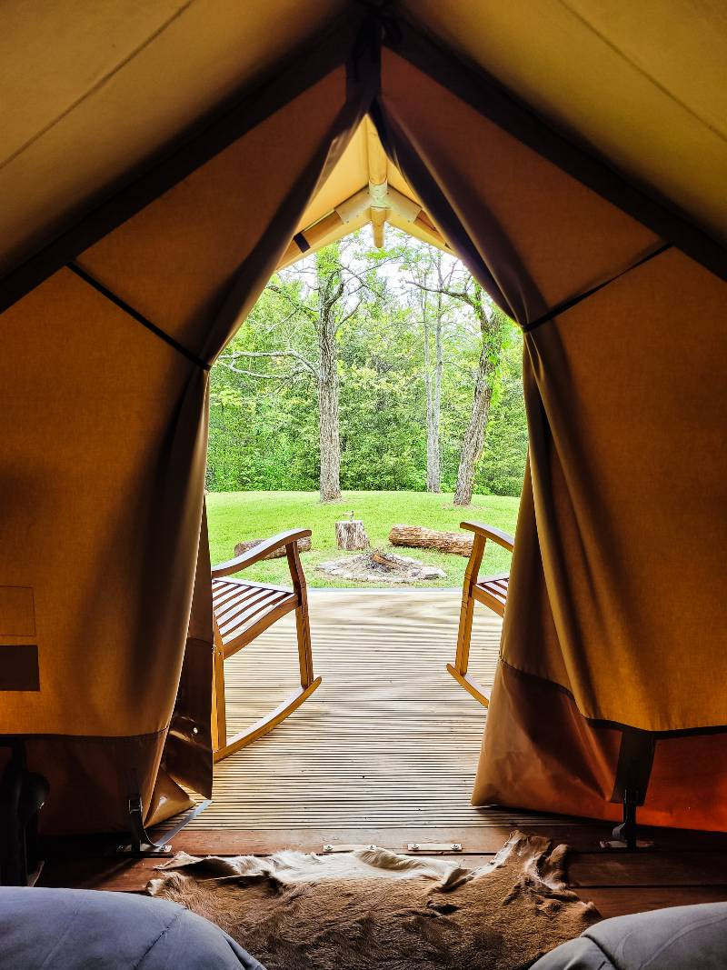 A view from inside a tent looking out at Tennessee glamping destination GlampKnox