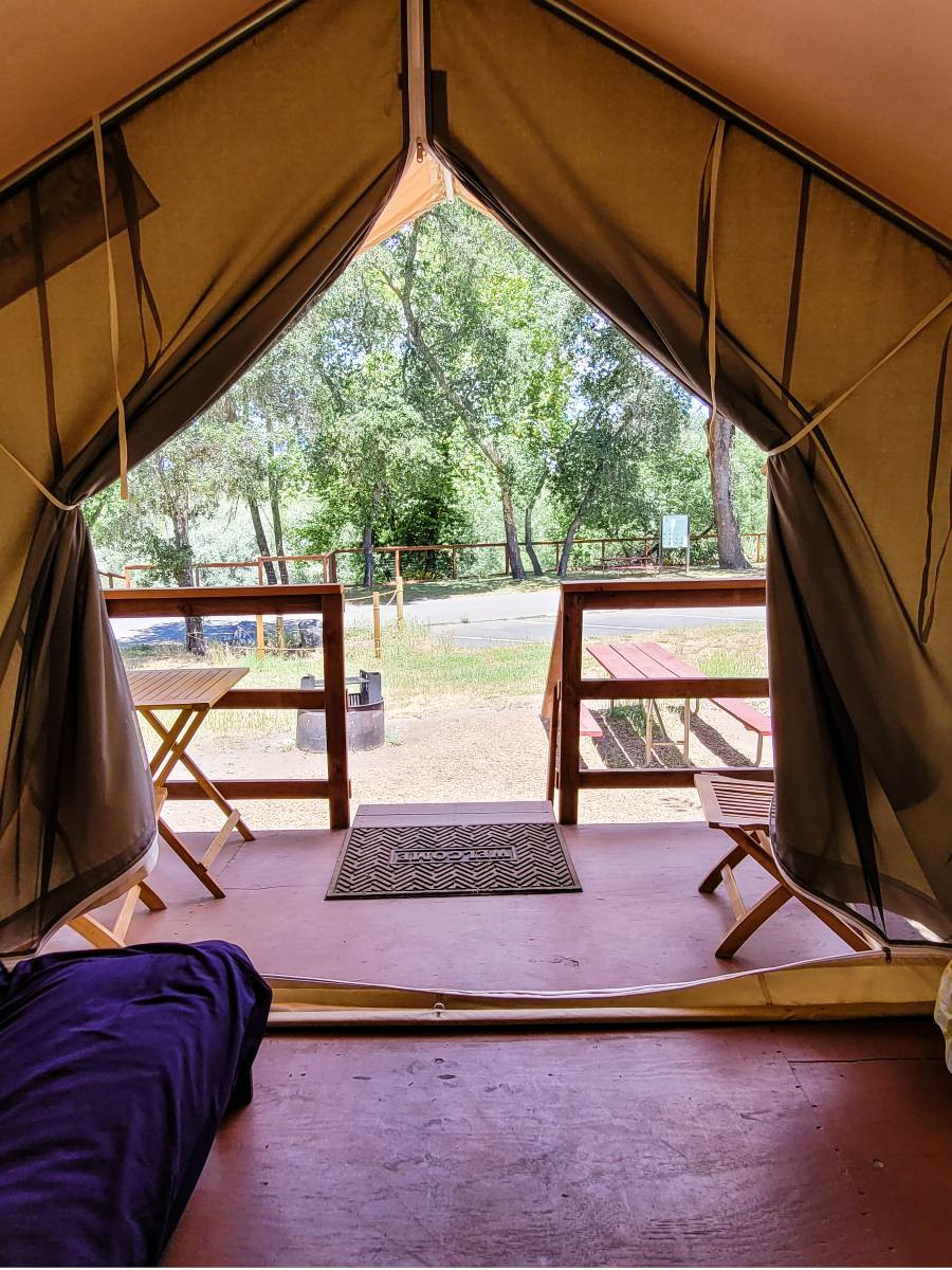 Looking out at the view from inside a tent at Wildhaven Sonoma, a Russian River glamping venue
