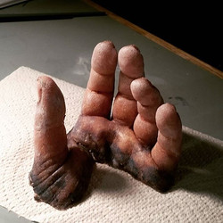 Dreaded severed silicone hand