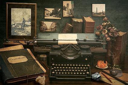 black-royal-typewriter-beside-black-book