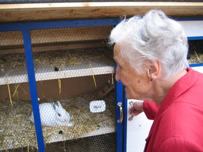 woman-old-grandma-hare-rabbit-hutch-depe