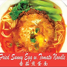 Noodle with fried egg on tomato sauce