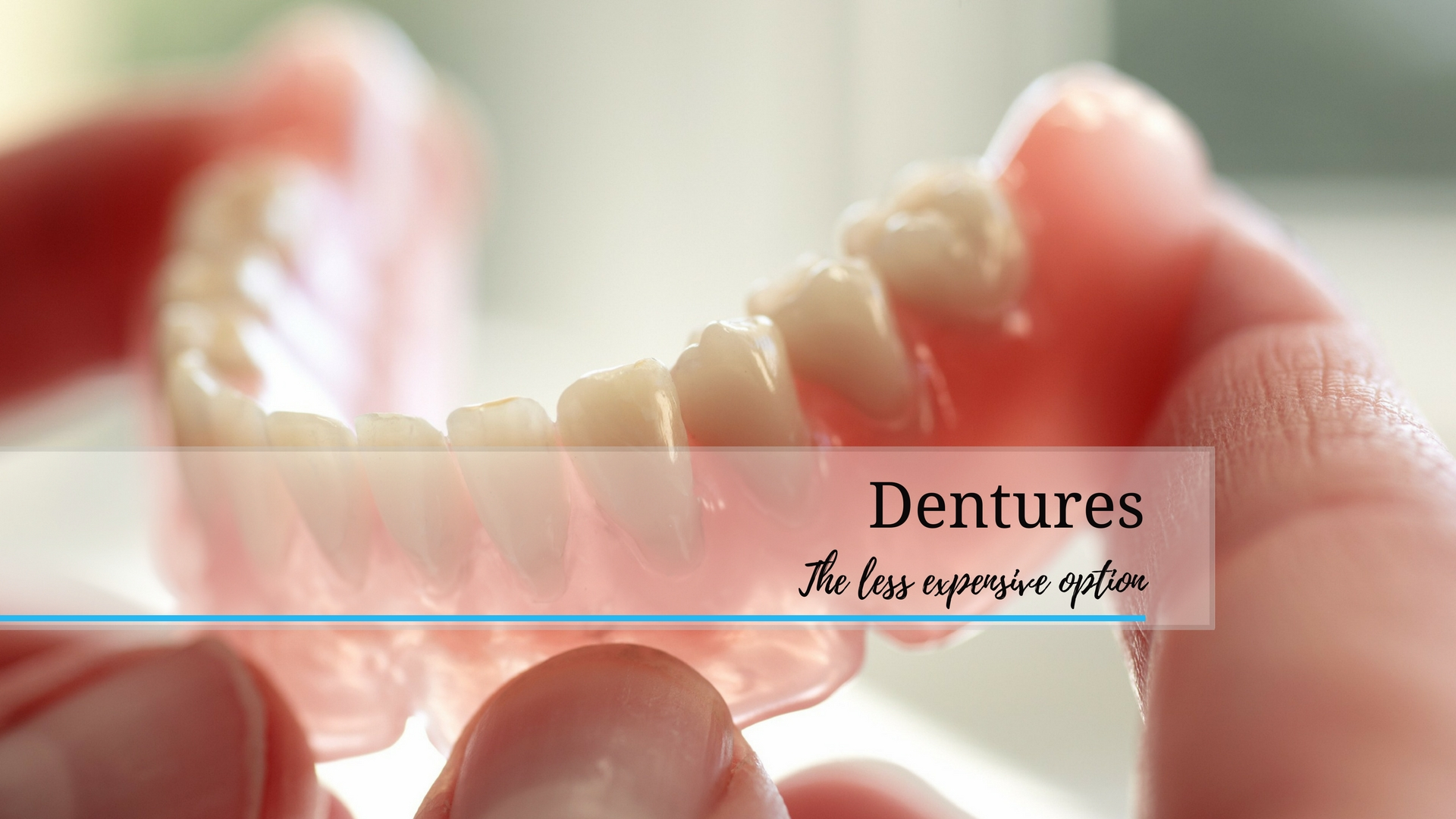 Dr Adel Rossouw holding dentures