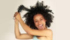 Afro-american-woman-detangling-hair-2 copy_edited.jpg