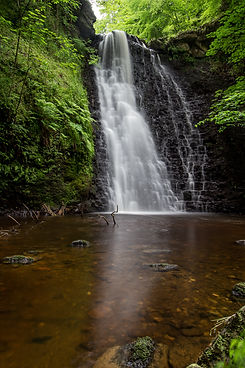 Large cascading waterfall tumbling into