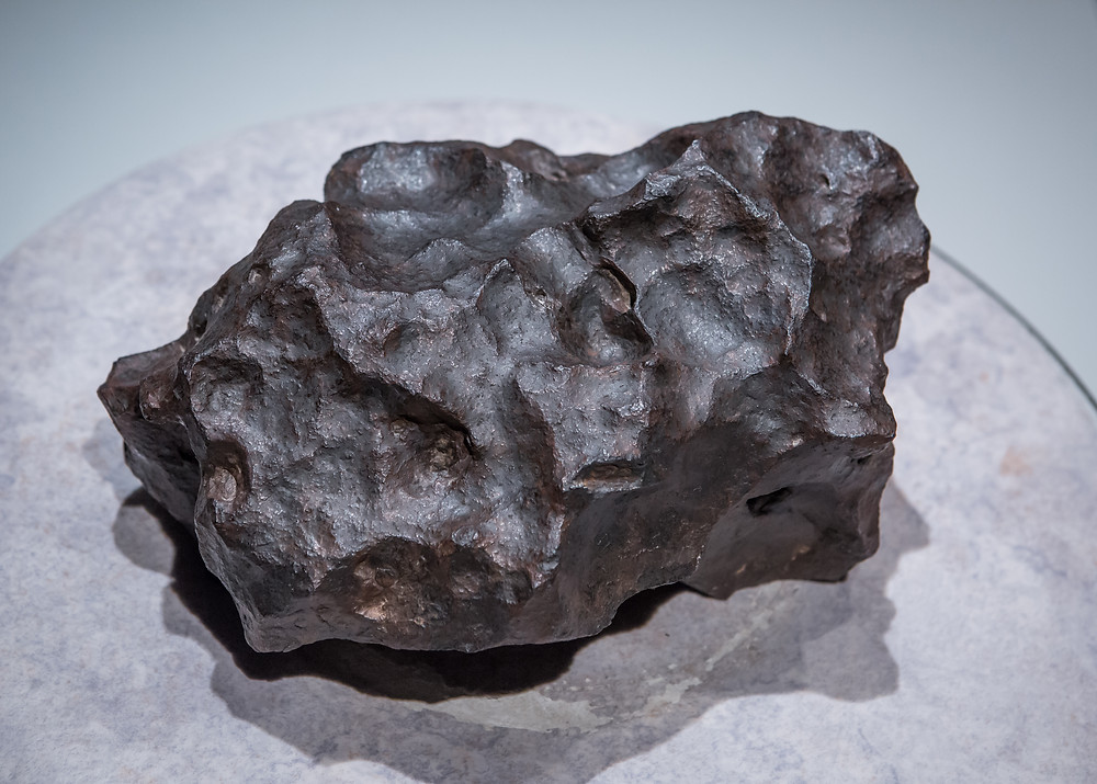 Meteorite with thumbprint surface from thermal ablations.