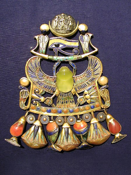 King Tutanhkamun's pendant with lime-green Moldavite in centre. Photo by Jon Bodsworth