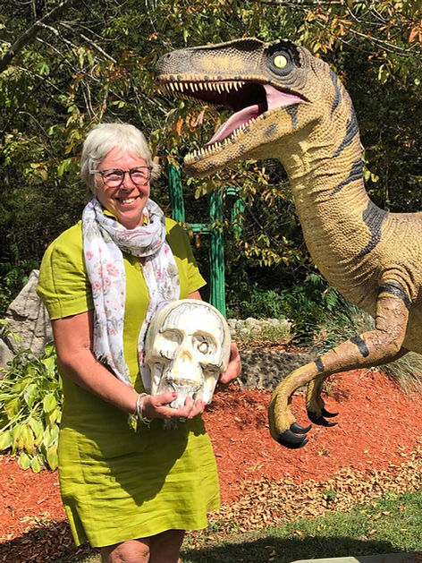 Lois with Dino, the mascott, and an onyx skull and dino mascott.jpg