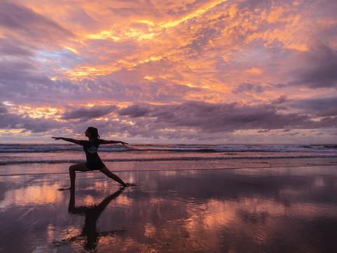 Sunrise yoga at Coolum Beach