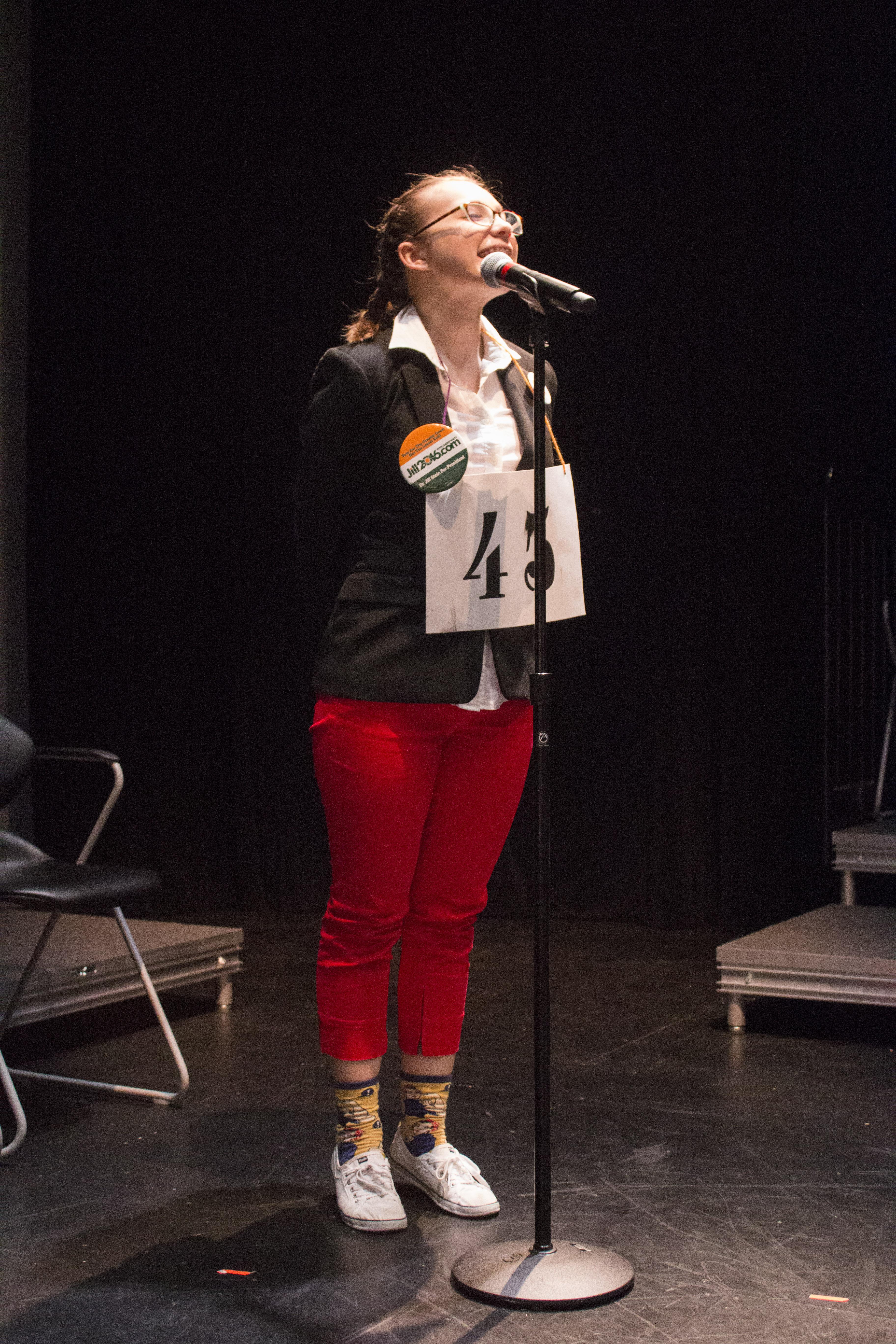 Abby Holmes as Logainne