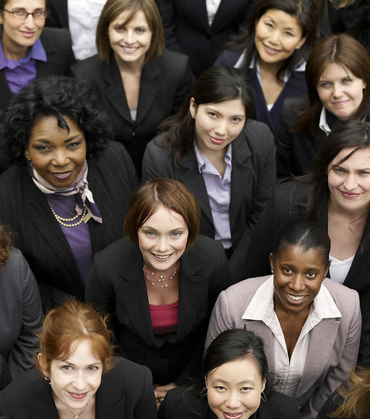 Elevated%20view%20of%20a%20group%20of%20smiling%20multiethnic%20businesswomen_edited.jpg