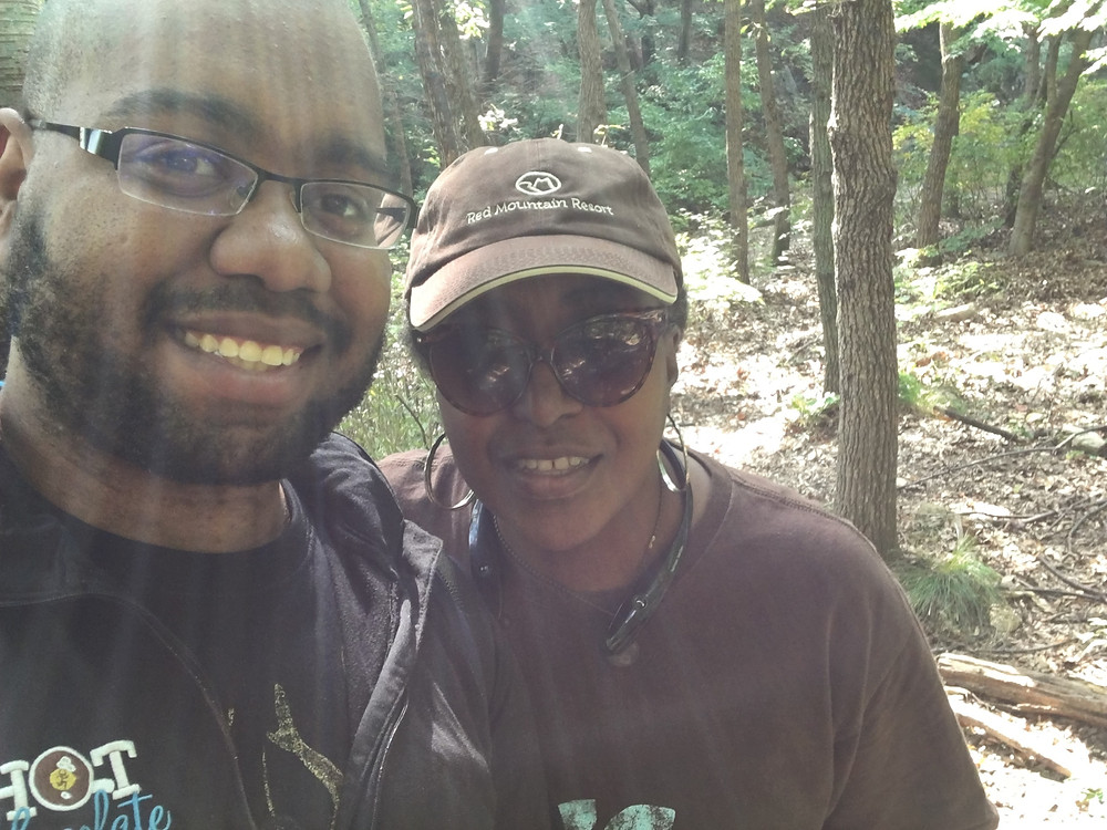 My Mom and I hiking a mountain.