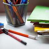 Student's desk, notebooks, textbooks, bo