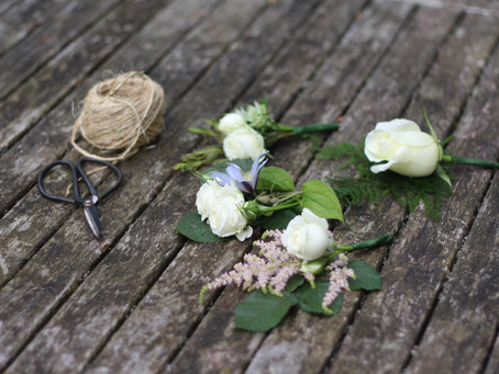 What's the difference between a buttonhole, boutonniere and corsage?