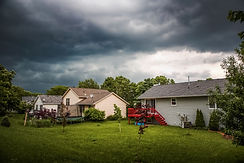 Thuderstorm clouds over suburban houses.