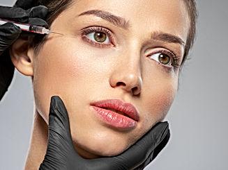 Young caucasian woman getting botox cosm