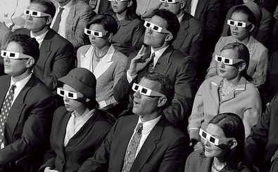 Vintage black and white photograph of an audience wearing 3D glasses