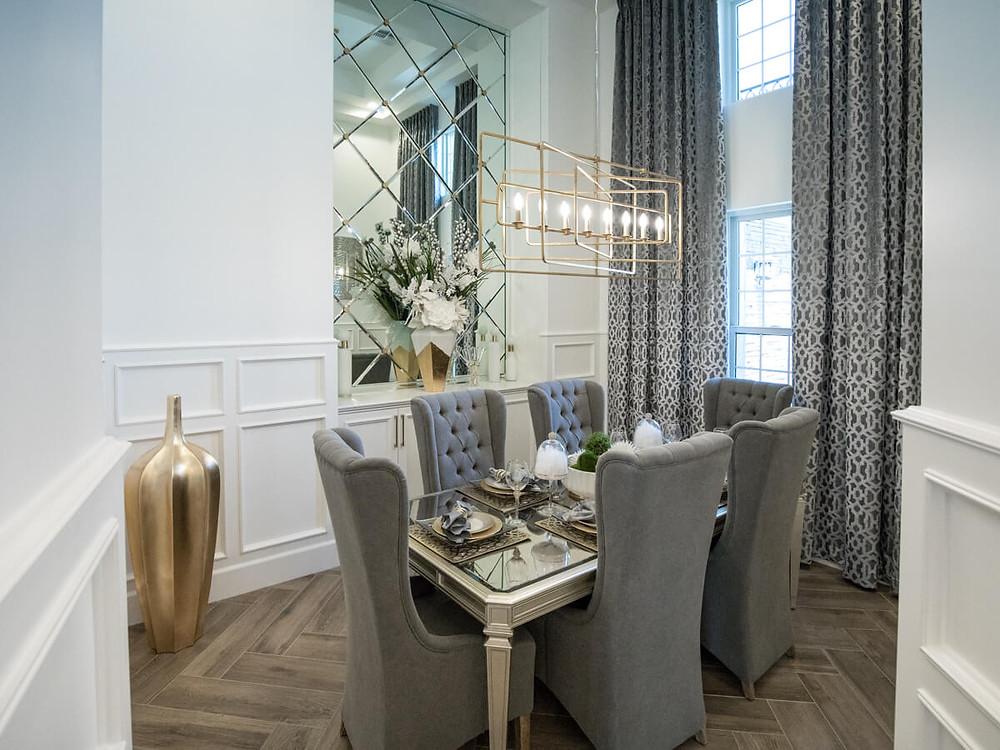 modern dining room with chevron wood flooring
