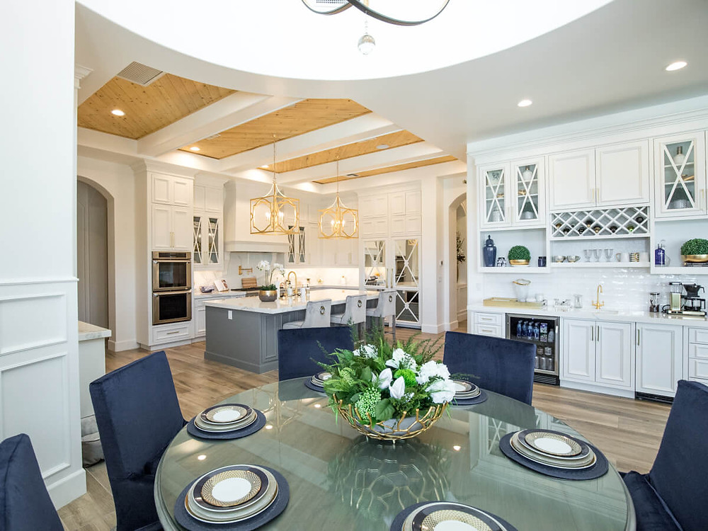 modern white kitchen with wood plank ceiling