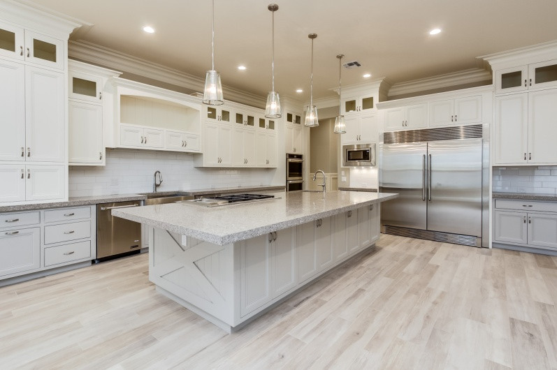 Large islands are creative workspaces in new custom kitchens.
