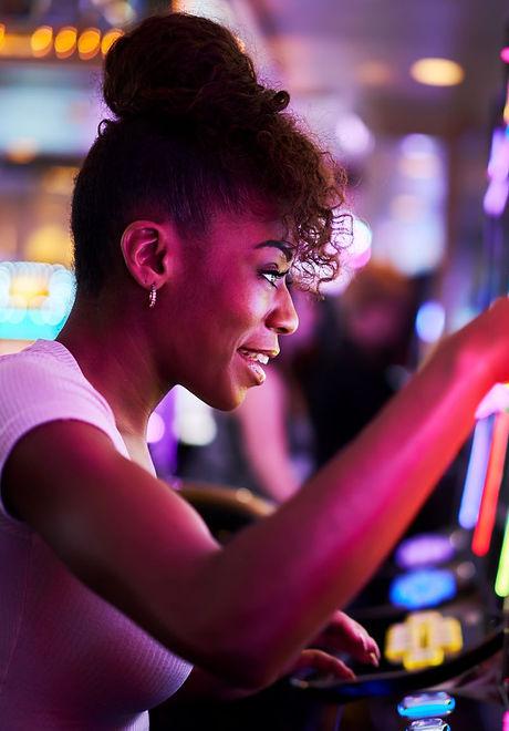 Canva - Happy Woman Gambling at Casino P
