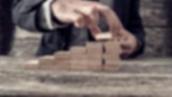 businessman-building-a-graph-or-ladder-o