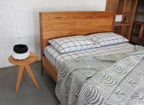 3 Sevens Side Table shown with bed