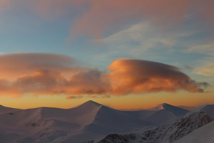 Clouds over mountains, photo by Yulia Dotsenko