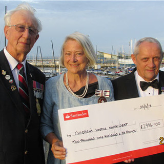 Chris Blick alongside Kate Adie CBE DL (BBC reporter Aden 1960s) and Robert Johnson, Chairman SW AVA with the cheque to the Childrens Hospice SW from monies raised by Peter's and Chis's sponsored walk