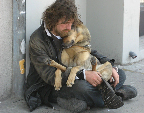 Homeless man and dog on the street
