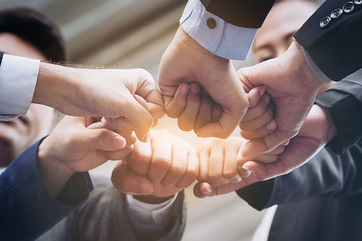Business People Joining Hands Showing Teamwork.jpg