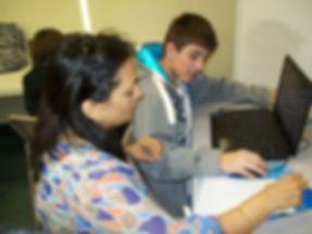 image: tutor providing help to a student on Khan Academy