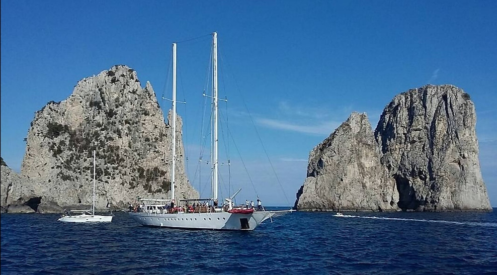 After boarding: head straight towards the island of Capri to toast the newlyweds in front of the Faraglioni of Capri