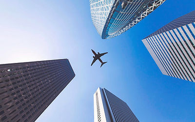 airplane-flys-between-tall-city-building