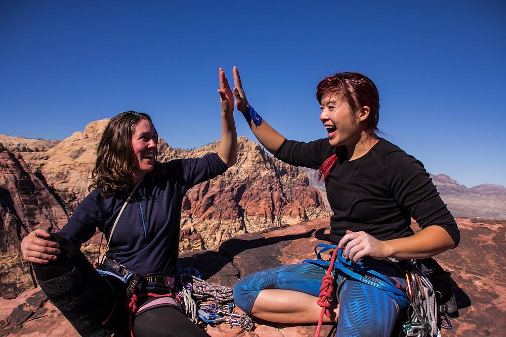 Climbers high fiving