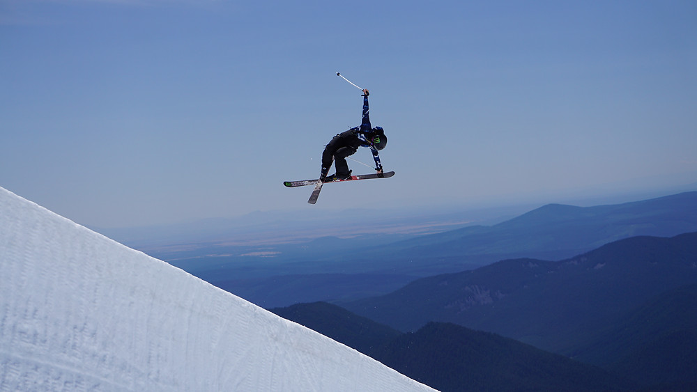 skier pulling a trick in the air