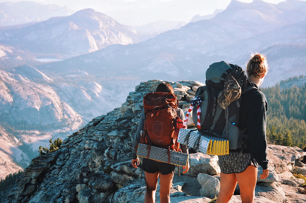 Two girls in Yosemite with backpacks.