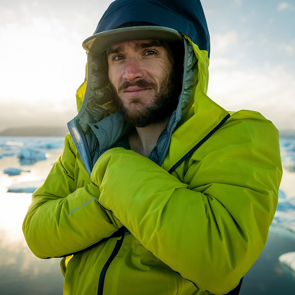 climber in front of ice burgs