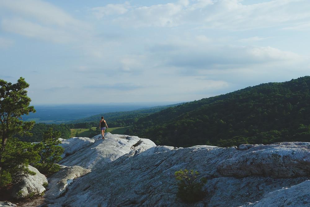 woman hiking through the mountains