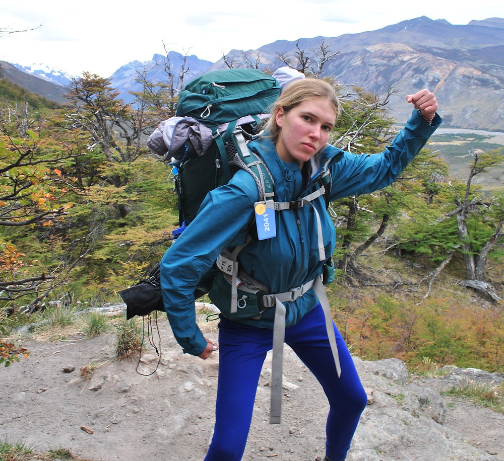 woman showing off her hiking gear