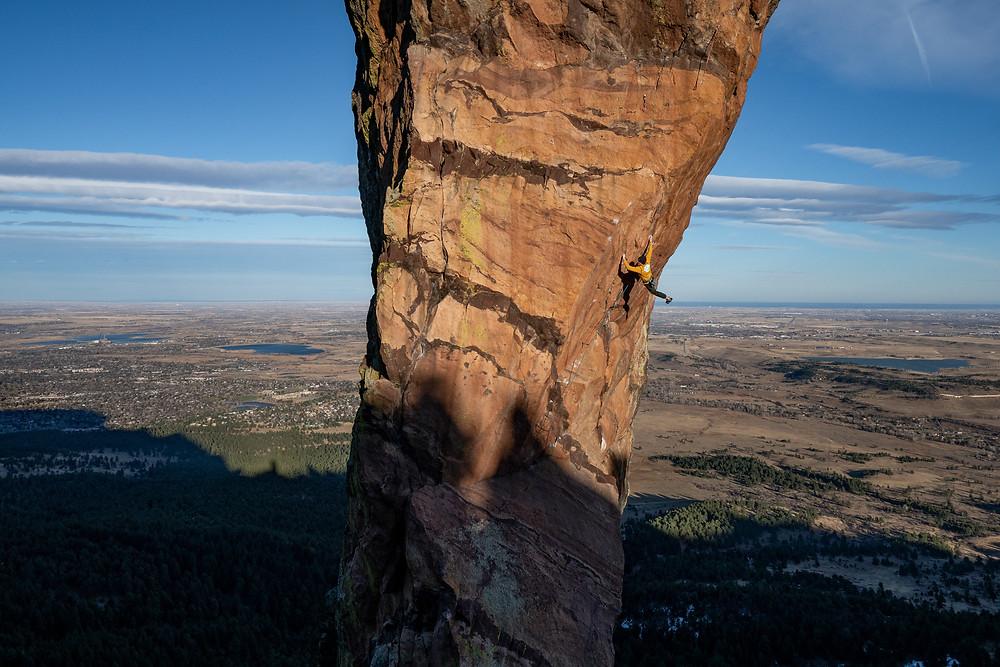 climber on rock spire