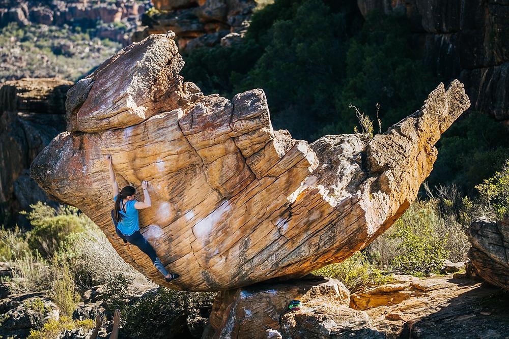 Kyra Condie climbs
