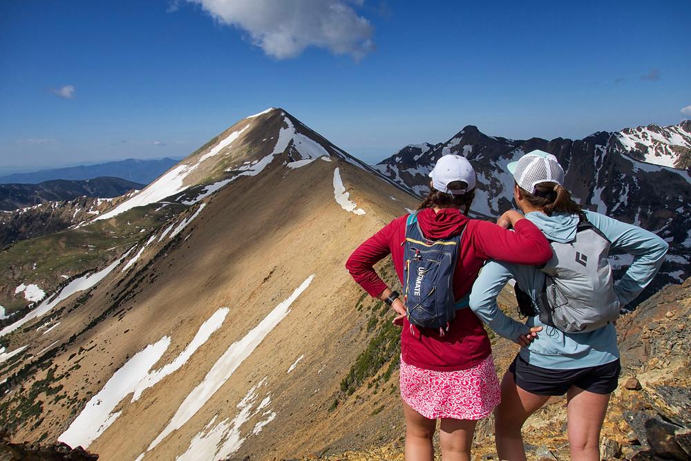 two girls looking at mountain peak