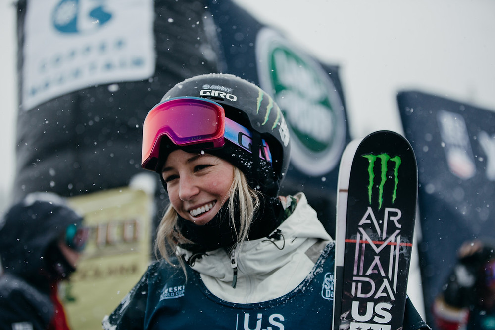 female skier with goggles and helmet