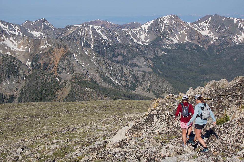 two girls walking through mountains